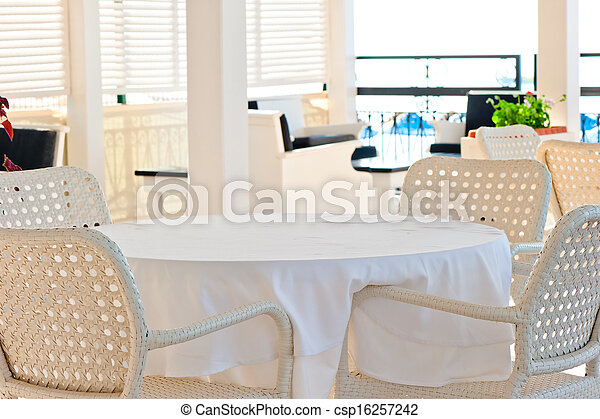 in the cafeteria wicker chairs and tables covered with cloth - csp16257242