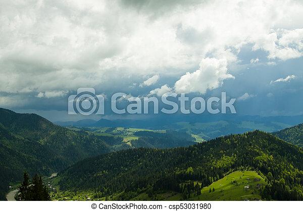 in the mountains rain starts - csp53031980