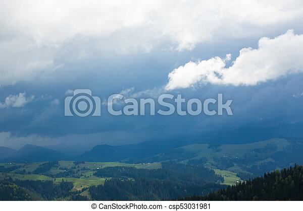 in the mountains rain starts - csp53031981