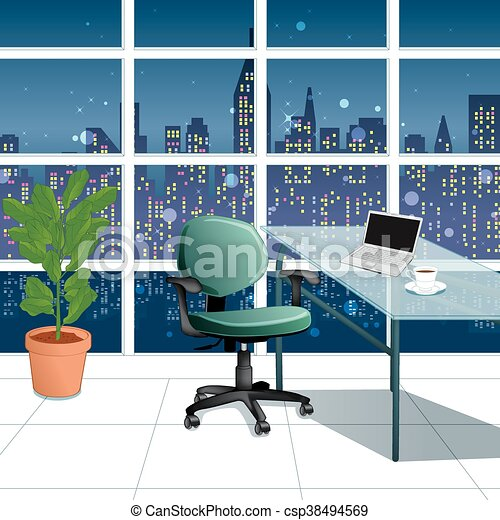 in the work office at night with a city view from window - csp38494569