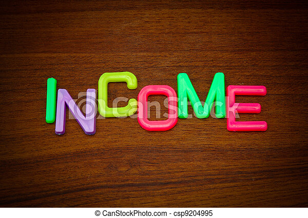 Income in colorful toy letters - csp9204995