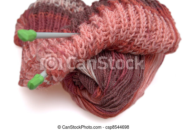 Incomplete a knitted scarf of claret color on a white background - csp8544698