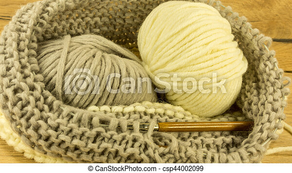 Incomplete knitting project with a woolen ball - csp44002099