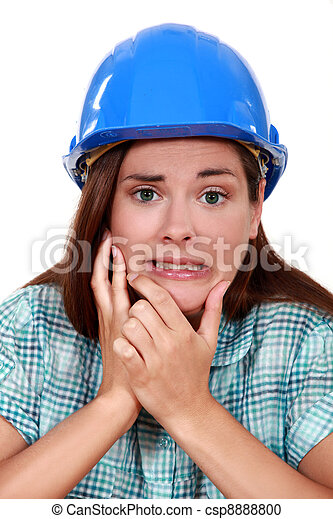 Indecisive woman in a hardhat - csp8888800