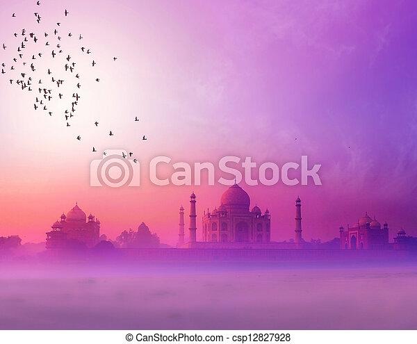 India. Taj Mahal sunset silhouette. Tajmahal palace in sunset sky - csp12827928