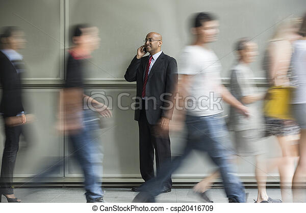 Indian Business man using a Cell Phone. - csp20416709