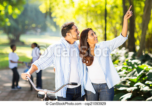 indian couple and kids enjoying being outdoors - csp21093929