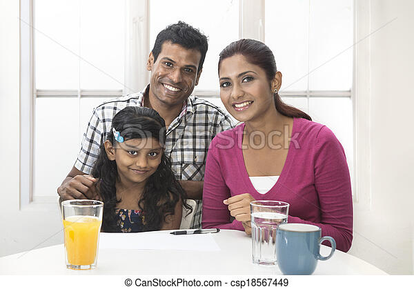 Indian family helping their child with her study work - csp18567449