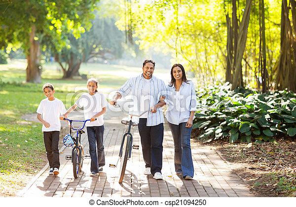 indian family walking outdoors - csp21094250