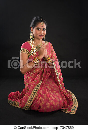 964cd686d2 Indian girl in a greeting pose, traditional sari costume, full ...