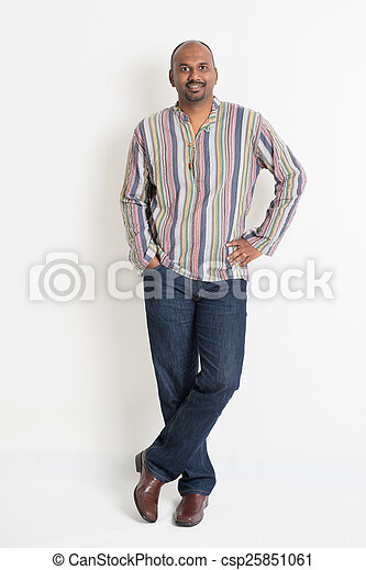 0a58a4fa3 Full length confident indian guy in casual wear standing on plain ...