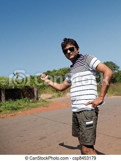 Indian man asking for liftcc - csp8453179
