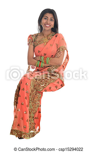 Indian woman seated on a transparent chair. - csp15294022