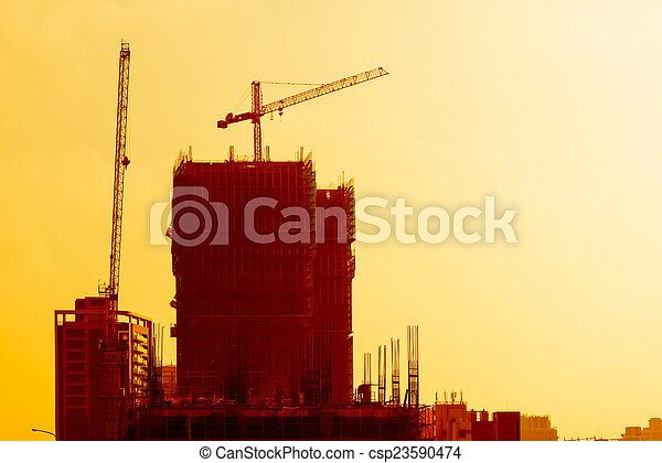 Industrial building site at sunset - csp23590474