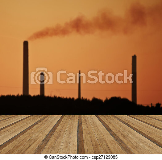 Industrial chimney stacks in natural landscape with wooden plank - csp27123085