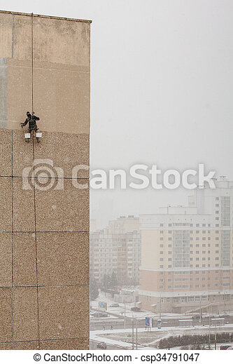 Industrial climber working - csp34791047