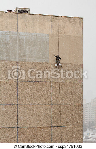 Industrial climber working - csp34791033