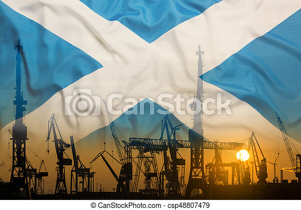 Industrial concept with Scotland flag at sunset, silhouette of container harbor