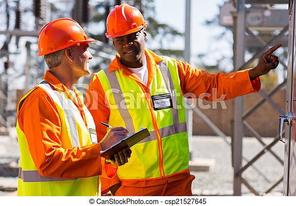 industrial electricians taking machine readings - csp21527645