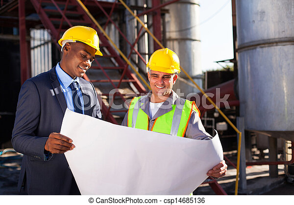 industrial engineers with blueprint - csp14685136
