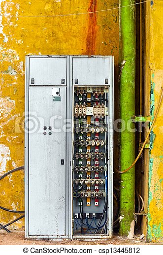 industrial fuse box on the wall closeup photo. | canstock  can stock photo