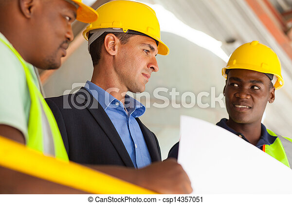 industrial manager and workers working on planning - csp14357051