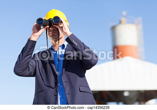 industrial manager with binoculars - csp14356239