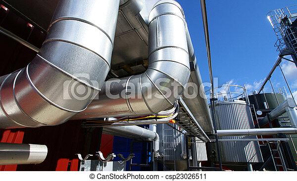 industrial pipelines on pipe-bridge against blue sky - csp23026511