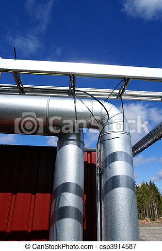 industrial pipelines on pipe-bridge against blue sky - csp3914587