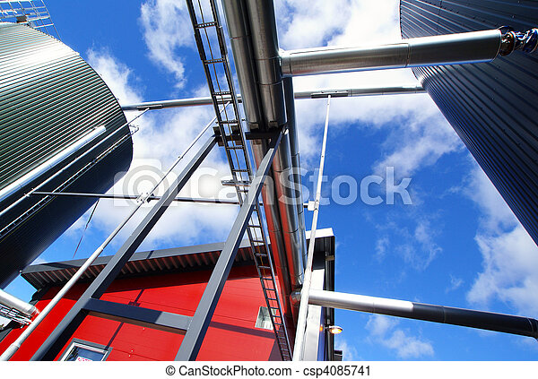 industrial pipelines on pipe-bridge against blue sky - csp4085741