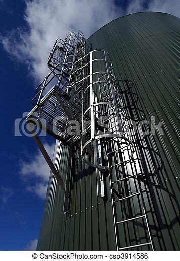 industrial pipelines on pipe-bridge against blue sky - csp3914586