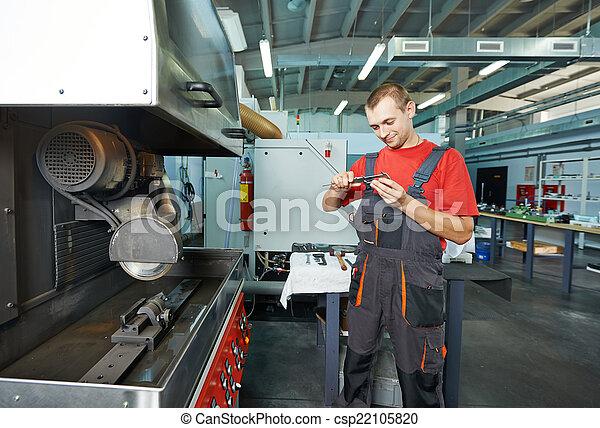 industrial worker at tool workshop - csp22105820