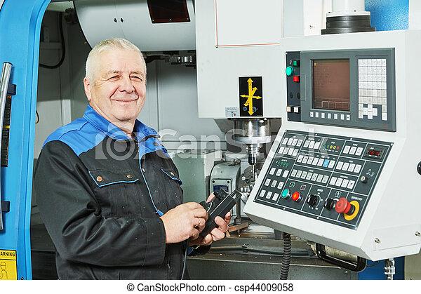 industrial worker measuring detail near cnc milling machine - csp44009058
