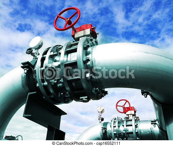 Industrial zone, Steel pipelines and valves against blue sky - csp16552111