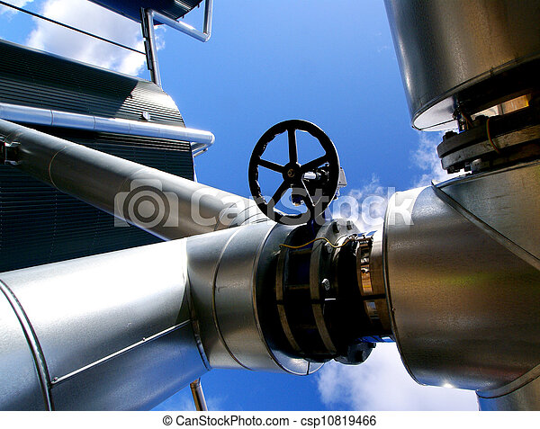 Industrial zone, Steel pipelines and valves against blue sky - csp10819466
