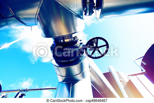 Industrial zone, Steel pipelines and valves against blue sky - csp48646467