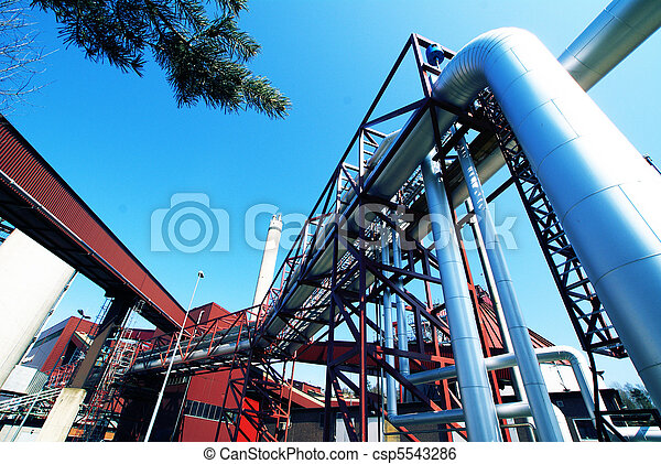 Industrial zone, Steel pipelines and valves against blue sky - csp5543286