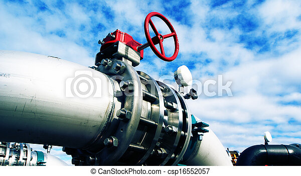 Industrial zone, Steel pipelines and valves against blue sky - csp16552057