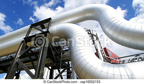 Industrial zone, Steel pipelines and valves against blue sky - csp16552153