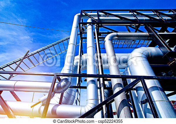 Industrial zone, Steel pipelines and valves against blue sky - csp52224355
