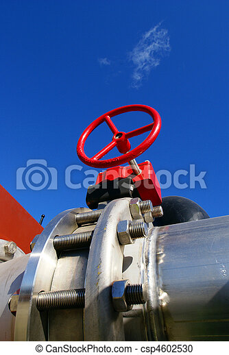 Industrial zone, Steel pipelines and valves against blue sky - csp4602530