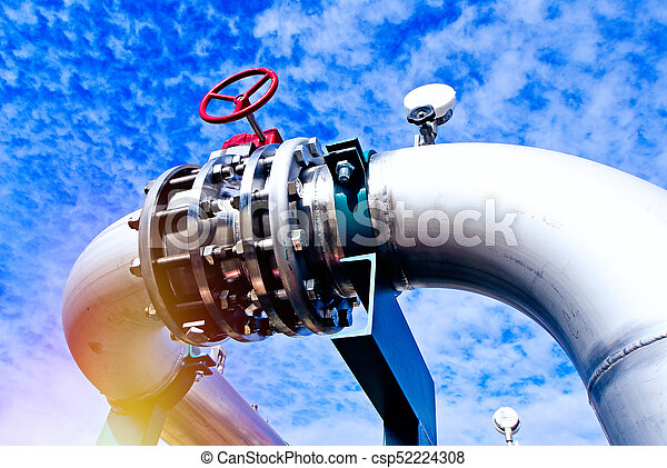 Industrial zone, Steel pipelines and valves against blue sky - csp52224308
