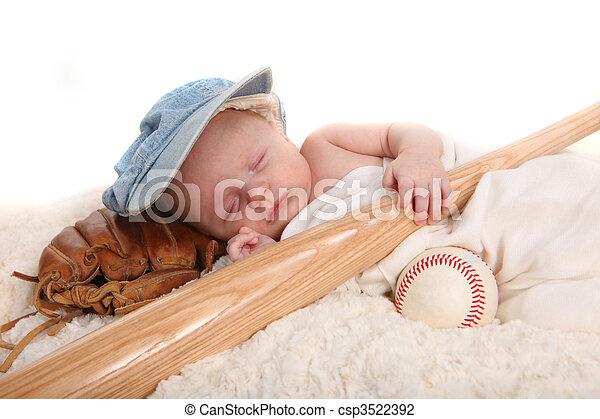 Infant Boy Holding Baseball Bat and Sleeping on a Glove - csp3522392