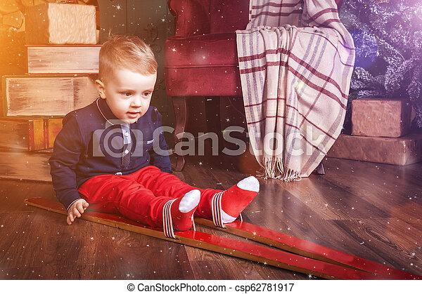 infant boy wearing ski - csp62781917