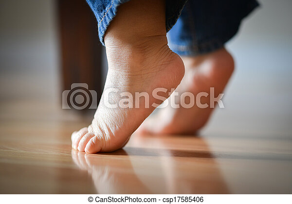 Infant's Precious Feet On Tippy Toes - Innocence Concept - csp17585406