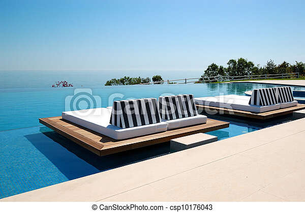 Infinity swimming pool by beach at the modern luxury hotel, Pieria, Greece - csp10176043