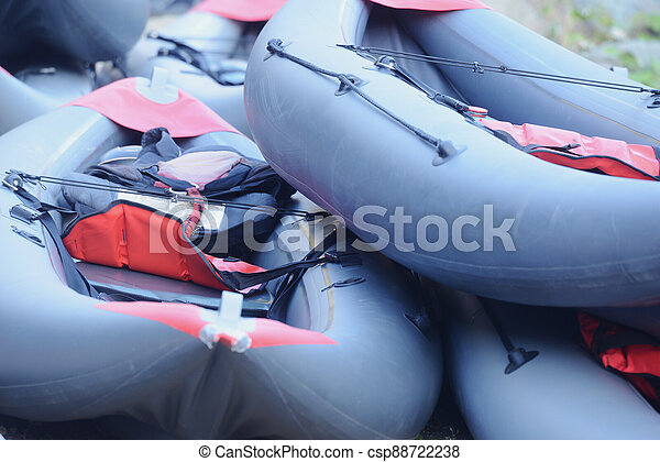 Inflatable boats on the mountain river shore. - csp88722238