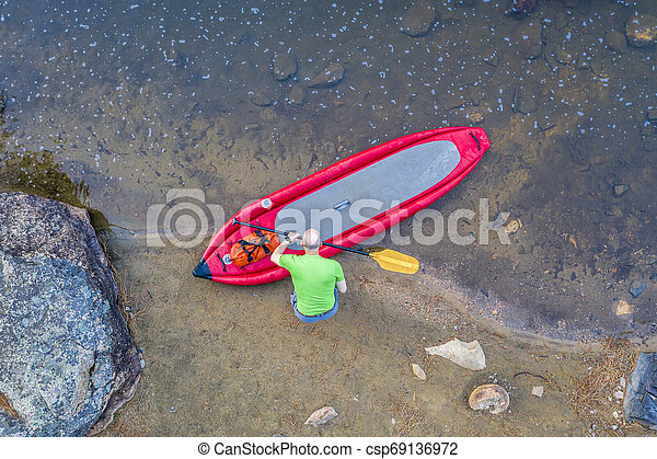 inflatable whitewater stand up paddleboard from above - csp69136972
