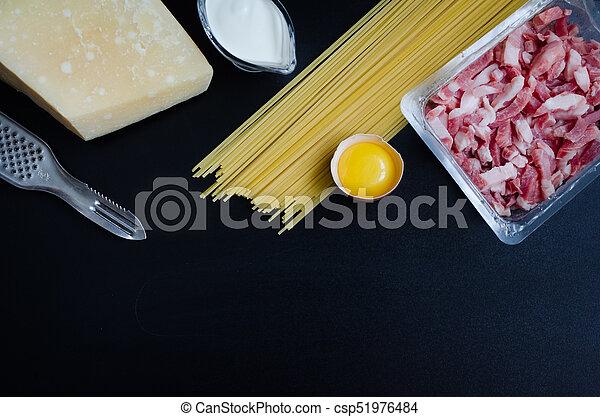 Ingredients for Pasta Carbonara on dark background - csp51976484