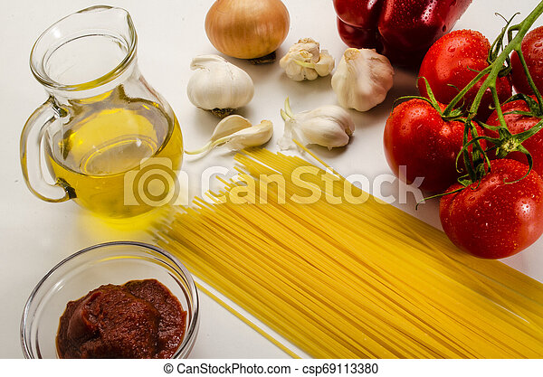 ingredients to make a delicious organic tomato sauce with spaghetti - csp69113380